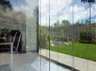 Frameless sliding walls